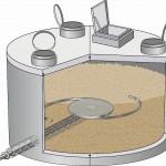 Über eine Schneckenförderung werden die Pellets aus dem unterirdischen Stahlbetonbehälter entnommen